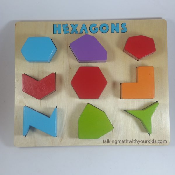 a 3 by 3 array of chunky irregular wooden hexagons in a puzzle frame